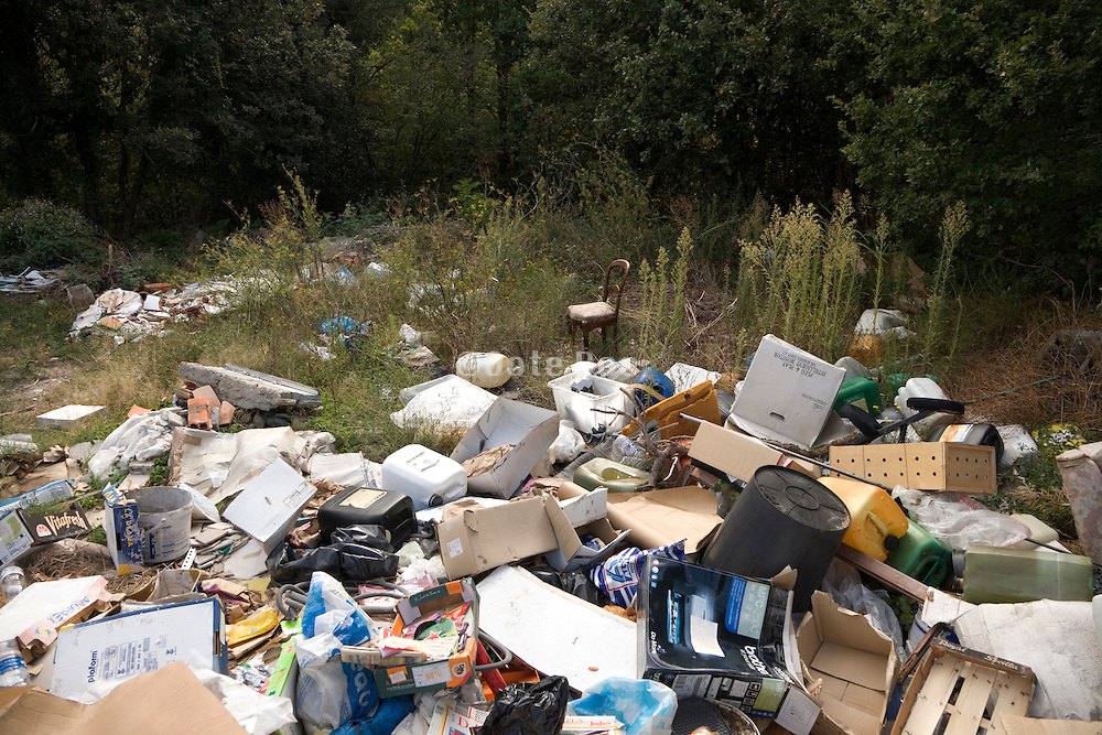 trash with household items dumped in the nature