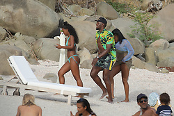 EXCLUSIVE: World's fastest man Usain Bolt chats to bikini babes while girlfriend Kasi Bennett has sand hand prints applied to her booty. The Jamaican sprinter and nine-time Olympic gold medalist chilled out while Kasi showed off her stunning physique in a skimpy yellow bikini while holidaying with friends in St Bart's. Casi, a brunette beauty from the Jamaican town of Old Harbour, is Bolt's long time girlfriend. 08 Jul 2018 Pictured: Usain Bolt. Photo credit: MEGA TheMegaAgency.com +1 888 505 6342