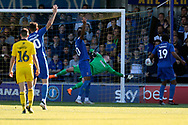 AFC Wimbledon goalkeeper Joe McDonnell (24) saving shot on goal during the EFL Sky Bet League 1 match between AFC Wimbledon and Oxford United at the Cherry Red Records Stadium, Kingston, England on 29 September 2018.