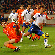 NLD/Amsterdam/20051112 - Voetbal, vriendschappelijke wedstrijd Nederland - Italie, Ron Vlaar (3) mist de bal waardoor Alberto Gilardino (11) kan scoren