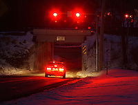 Middletown, New York -  A car stops at a traffic light at twilight on Jan. 9, 2011.