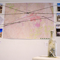 """A map of Gallup has the sites of exposure deaths marked in the """"Exposure"""" exhibit at Art123 Gallery in Gallup Thursday."""