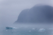 Icebergs from the Columbia Glacier float past as mist shrouds the coast in Prince WIlliam Sound near Valdez, Alaska.
