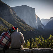 A couple relaxes during sunrise at Tunnel View inside Yosemite National Park on Sunday, September 22, 2019 in Yosemite, California. (Alex Menendez via AP)
