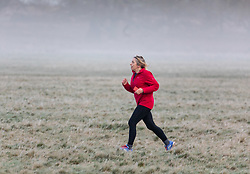 © Licensed to London News Pictures. 23/01/2021. London, UK. Runners and walkers enjoy a frosty and misty start with lows of -2 in Richmond Park South West London this morning. A chilly weekend ahead is forecast for the South East with the Met Office issuing a yellow weather warning for ice and snow for today and tomorrow. Photo credit: Alex Lentati/LNP