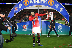 26 February 2017 - EFL Cup Final - Manchester United v Southampton - Paul Pogba of Manchester United with his trademark 'dab' as he holds the trophy - Photo: Marc Atkins / Offside.