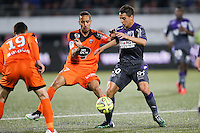 Wissam BEN YEDDER / Walid MESLOUB - 18.04.2015 - Lorient / Toulouse - 33eme journee de Ligue 1<br />Photo : Vincent Michel / Icon Sport