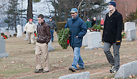 Laconia Rotarians placed holiday wreaths onto the grave sites of 455 New Hampshire veterans Saturday afternoon at Bayside Cemetery for the annual Wreaths Across America event.  (Karen Bobotas/for the Laconia Daily Sun)