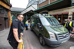 © Licensed to London News Pictures. 12/06/2017. London, UK. A delivery van leaves Borough Market as traders begin clearing up and prepare to reopen. The market was the scene of a terrorist attack on Saturday 3 June 2017 in which eight people were killed. Photo credit: Rob Pinney/LNP