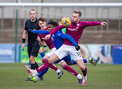 06MAR21 Queen of the South's Adedapo Awokoya-Mebude and Arbroath's Scott Stewart. Arbroath 2 v 4 Queen of the South, Scottish Championship played 6/3/2021 at Arbroath's home ground, Gayfield Park.
