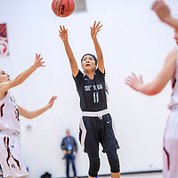 Tse' Yi' Gai Dené Warrior Janiece Commanche (11), center, attempts a three-point goal on the Fort Sumner Vixens in a District 2A quarterfinal at Bernalillo High School in Bernalillo Tuesday.
