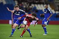 Diego Fabbrini of Middlesbrough breaks away from Cardiff's Aron Gunnarsson (l).  Skybet football league championship match, Cardiff city v Middlesbrough at the Cardiff city Stadium in Cardiff, South Wales  on Tuesday 20th October 2015.<br /> pic by  Andrew Orchard, Andrew Orchard sports photography.