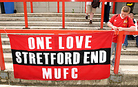 Picture by Daniel Hambury.<br /> 23/07/05.<br /> AFC wimbledon v Football Club United of Manchester. Pre season friendly.<br /> A sign from the Stretford End of Old Tarfford is hung is the slighty less glamourous Kingsmeadow.