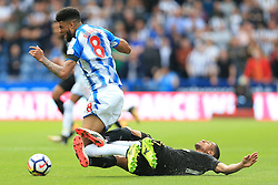 20th August 2017 - Premier League - Huddersfield Town v Newcastle United - Isaac Hayden of Newcastle wraps his legs around Philip Billing of Huddersfield - Photo: Simon Stacpoole / Offside.