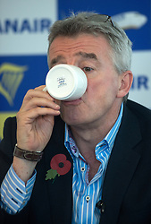 © Licensed to London News Pictures.04/11/2013. London, UK.Michael O'Leary, chief executive officer of Ryanair Holdings Plc drinks coffee during a media briefing on Ryanair's half year results for the period.Photo credit : Peter Kollanyi/LNP