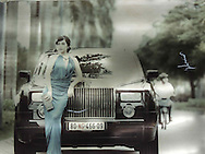 Elegant Vietnamese woman leans against a Rolls Royce in a billboard advertisement for future luxury apartments, Hanoi, Vietnam, Southeast Asia