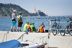 Bikers resting on jetty with bikes
