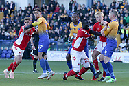 Naby Sarr of Charlton Athletic (23) appeals for a penalty against Neal Bishop of Mansfield Town (6) during the The FA Cup match between Mansfield Town and Charlton Athletic at the One Call Stadium, Mansfield, England on 11 November 2018.