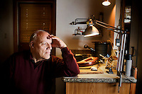 Robert Gable, a retired psychologist, shows an electonic monitoring device for offenders used in the mid 1960s, in the studio of his home in Berkeley, Ca., on Friday, Oct. 29, 2010. Mr. Gable and his twin brother, Kirk, not pictured, invented the belt as graduate students at Harvard University. The invention was intended for positive re-enforcement that monitored and, and later rewarded, the offender for attending classes, sessions or a job. As technology improved, the belt was then used more as a tool for punishment.