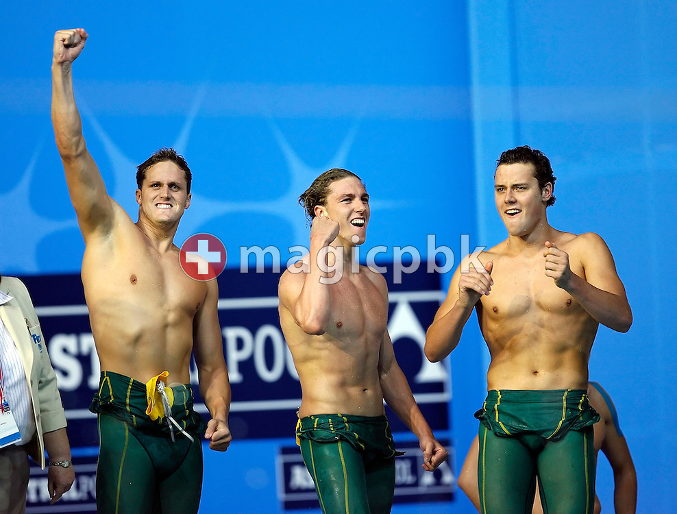 (L-R) Andrew Mewing, Grant Brits and Patrick Murphy of Australia celebrate following their silver medal in the men's 4x200m freestyle relay final in the Susie O'Neill pool at the FINA Swimming World Championships in Melbourne, Australia, Friday 30 March 2007. (Photo by Patrick B. Kraemer / MAGICPBK)