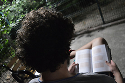 August 7, 2017 - Ankara, Turkey - A man reads an educational book in Ankara, Turkey on August 07, 2017. The Turkish government takes a giant step in Turkey's education system with several critical changes. According to the new system, Charles Darwin's theory of evolution is no longer in the new curriculum. The concept of Islamic Jihad enters into the new curriculum at various levels. The steps of contemporary Turkey and the units of Mustafa Kemal Ataturk, founder and the first president of the Republic of Turkey, are combined under a single unit. Economical, political and social representation; women's issues such as violence and gender discrimination are also emphasized in the new curriculum. The new curriculum includes new topics such as internet, technology and game addiction, obesity, and current social issues. Eurasia Tunnel, Maltepe Coastal Park, Osman Gazi Bridge, and Marmaray Project are used as an example for the use of natural habitat in the new geographical curriculum. The July 15 Democracy and National Unity Day is presented to middle school students under an active citizenship lesson. Some subjects in physics and chemistry courses are left to the upper level of the curriculum. The philosophy course starts to be processed from the 10th grade and the name of the physical education course is changed to physical education and sports. (Credit Image: © Altan Gocher/NurPhoto via ZUMA Press)