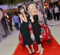Left to right, DAISY LOWE and Marilyn Monroe lookalike SUZI KENNEDY at a private view of Marilyn - The Legacy of a Legend held at the Design Centre, Chelsea Harbour, London on 25th May 2016.