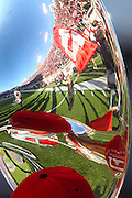 A Utah Utes flag carrier is reflected off a tuba before an NCAA college football game against Oregon State at Rice-Eccles Stadium, Saturday, Oct. 29, 2011, in Salt Lake City.  (AP Photo/Colin E. Braley).