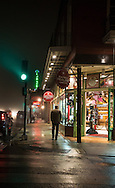 January 9, 2013, New Orleans LA, Tourist Decuater Street on a foggy night in the French Quarter.