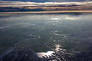 Luchtfoto Leeuwarden richting Grou. Op voorgrond Zuiderburen, bovenaan Pikmeer bij Grou en Alde Feanen. De laaghangende bewolking doet denken aan de branding bij zee.