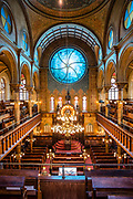 The sancuary of the synagogue of the congregation Kahal Adath Jeshurun, built in 1887, and now the home of the Museum at Eldridge Street. The stained glass window is by artist Kiki Smith and architect Deborah Gans.