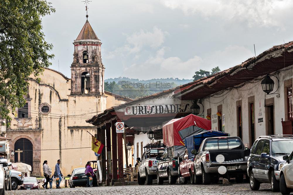 The Templo de la Companía church rises above the tile roofs in Patzcuaro, Michoacan, Mexico.