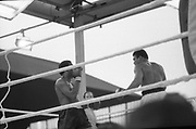 Ali vs Lewis Fight, Croke Park,Dublin.<br /> 1972.<br /> 19.07.1972.<br /> 07.19.1972.<br /> 19th July 1972.<br /> As part of his built up for a World Championship attempt against the current champion, 'Smokin' Joe Frazier,Muhammad Ali fought Al 'Blue' Lewis at Croke Park,Dublin,Ireland. Muhammad Ali won the fight with a TKO when the fight was stopped in the eleventh round.<br /> <br /> Both fighters are pictured as there is a pause in the action.