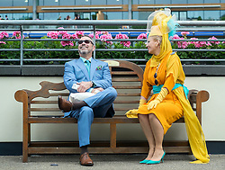 © Licensed to London News Pictures. 19/06/2014. Ascot, UK. Marta and Alan Galza from Cleveland, Ohio, take in the atmosphere.  Day three, Ladies Day, at Royal Ascot 19th June 2014. Royal Ascot has established itself as a national institution and the centrepiece of the British social calendar as well as being a stage for the best racehorses in the world. Photo credit : Stephen Simpson/LNP