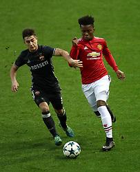 CSKA Moscow's Konstantin Maradishvili (left) and Manchester United's Ethan Laird battle for the ball