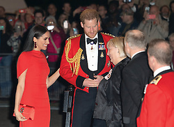 Prince Harry, Duke of Sussex and Meghan, Duchess of Sussex arrive at the Royal Albert Hall in London to attend the Mountbatten Festival of Music on March 07, 2020.