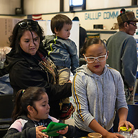 Erica Long and her children Tamia Washburn, 10, Rozario Long, 6, and Lincoln Washburn, 1, enjoy making crafts at the annual America Recycles Day Recycled Crafts Fair at the Gallup Community Service Center on November 2, 2019.