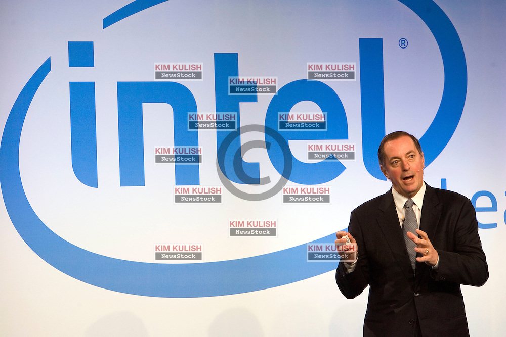 File photo: (2006) Intel Corporation CEO Paul Otellini geatures on stage as he announces Intel's new vPro technology in San Francisco.   Intel Corporation announced July 13, 2006  that they will fire 1,000 managers this week.  Industry analysts are reporting more than 10,000 jobs will be cut later this year by the chip giant.   Photo by Kim Kulish
