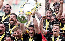 Saracens inside centre Brad Barritt lifts the Aviva Premiership trophy as Saracens are crowned Aviva Premiership champions  - Mandatory by-line: Joe Meredith/JMP - 17/01/2014 - RUGBY - Twickenham - London, England - Saracens v Exeter Chiefs - Aviva Premiership Final