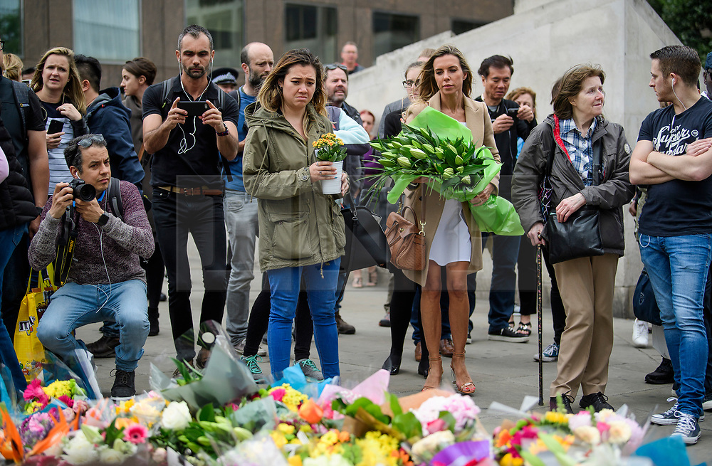 © Licensed to London News Pictures. 05/06/2017. London, UK. Members of the public lay flowers at London Bridge, in memory of those who lost their lives in the London Bridge terror attack. Three men attacked members of the public  after a white van rammed pedestrians on London Bridge. Ten people including the three suspected attackers were killed and 48 injured in the attack. Photo credit: Ben Cawthra/LNP