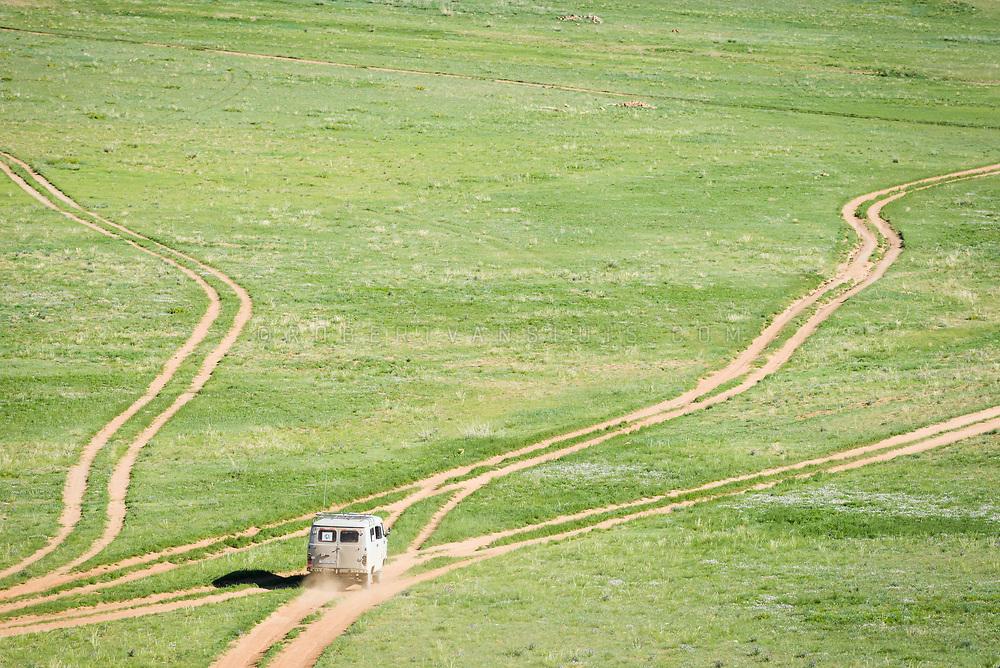 A Russian van drives on unpaved roads near the Baga Gazryn Chuluu rock formations, Mongolia. Photo © Robert van Sluis - www.robertvansluis.com