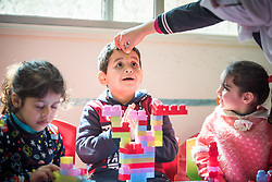 17 February 2020, Zarqa, Jordan: A boy receives a small star attached onto his forehead by his nanny at the Lutheran World Federation community centre in Zarqa. Through a variety of activities, the Lutheran World Federation community centre in Zarqa serves to offer psychosocial support and strengthen social cohesion between Syrian, Iraqi and other refugees in Jordan and their host communities.