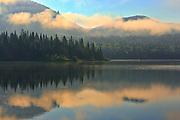 Fog and reflection on Lac La Joie at sunrise<br />Parc national du Mont Tremblant<br />Quebec<br />Canada