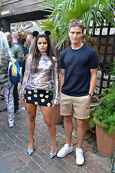 BIP LING and OLIVER CHESHIRE at the Warner Music Group Summer Party in association with British GQ held at Shoreditch House, Ebor Street, London E2 on 8th July 2015.