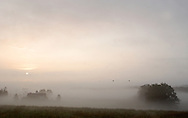 Wawayanda, NY - The sun starts to burn through the fog around a barn on the morning of Oct. 1, 2008.