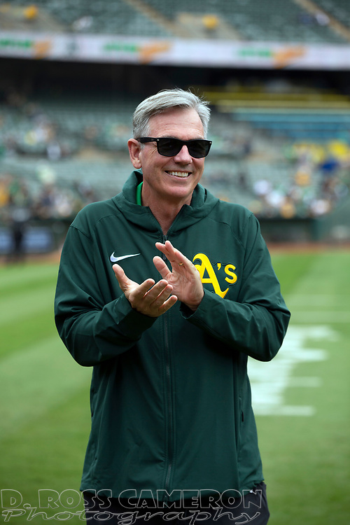 Sep 26, 2021; Oakland, California, USA; Oakland Athletics Executive Vice President of Baseball Operations Billy Beane applauds retiring A's equipment manager Steve Vucinich during a ceremony before a game against the Houston Astros at RingCentral Coliseum. Mandatory Credit: D. Ross Cameron-USA TODAY Sports