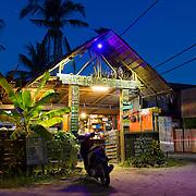 Ruang Caffaye with bike near Cenang beach, Langkawi, Malaysia