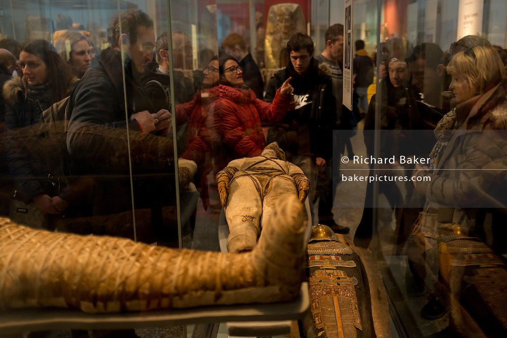 Visitors crowd around the popular Ptolemaic/Roman Mummies in the British Museum, on 28th February 2017, in London, England.