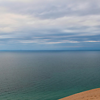 Wonderful blue hues both in the sky, and water on lovely Lake Michigan! <br /> Steps in the sand lead nearly to the edge of the dunes!