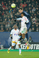 FOOTBALL - FRENCH CHAMPIONSHIP 2012/2013 - L1 - PARIS SAINT GERMAIN v OLYMPIQUE MARSEILLE - 24/02/2013 - PHOTO JEAN MARIE HERVIO / REGAMEDIA / DPPI - ZLATAN IBRAHIMOVIC (PSG) / NICOLAS NKOULOU (OM)