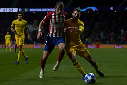 November 6, 2018 - Madrid, Spain - Filipe Luis of Atletico Madrid and Lukasz Piszczek of Borussia Dortmund battle for the ball during the Group A match of the UEFA Champions League between AtleticoLucien Favre of Borussia Dortmund Madrid and Borussia Dortmund at Wanda Metropolitano Stadium, Madrid on November 07 of 2018. (Credit Image: © Jose Breton/NurPhoto via ZUMA Press)